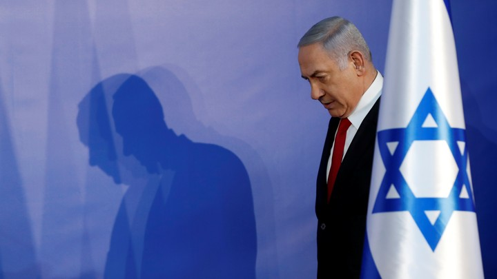 Israeli Prime Minister Benjamin Netanyahu arrives to deliver a statement to the media in his residency in Jerusalem